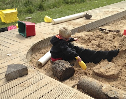 Got a sandpit? Why not add a few natural loose parts?